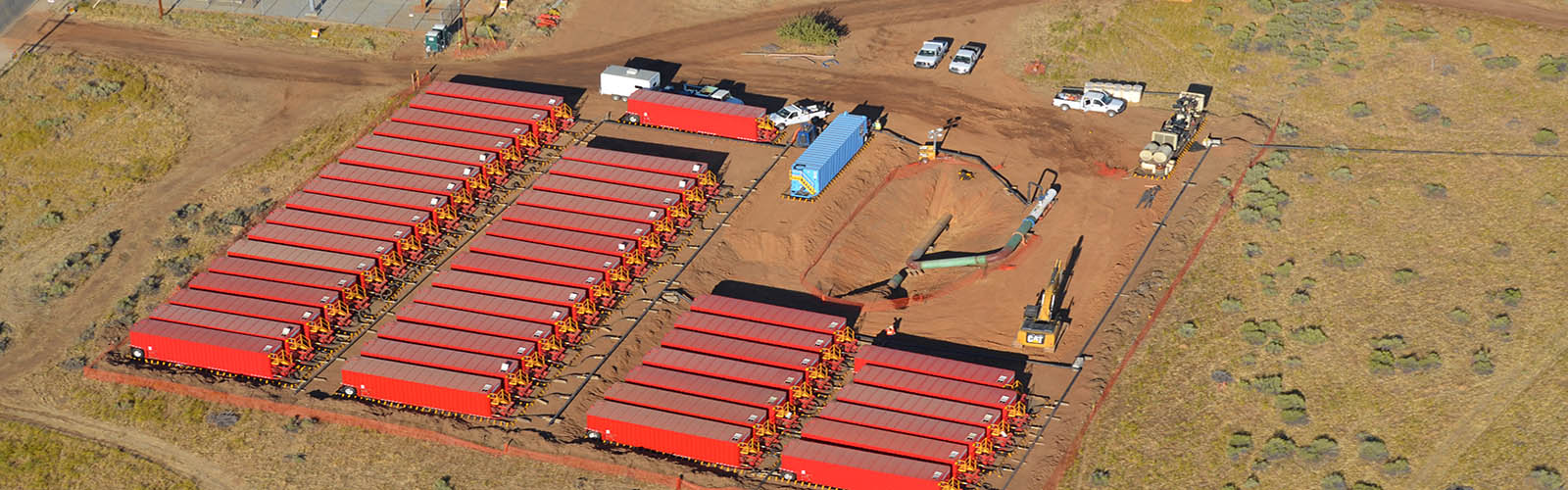 A large amount of trailers holding water and a pipeline being hydrostatic tested