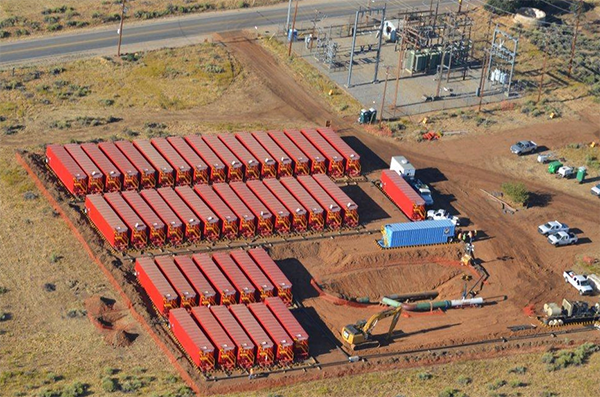 A large amount of trailers hold water as construction workers test a pipeline
